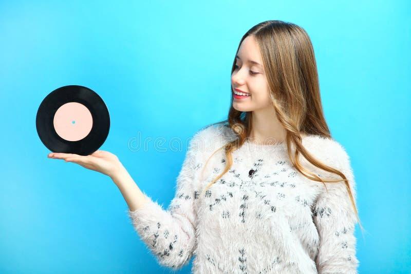 Girl with a vinyl record royalty free stock photos