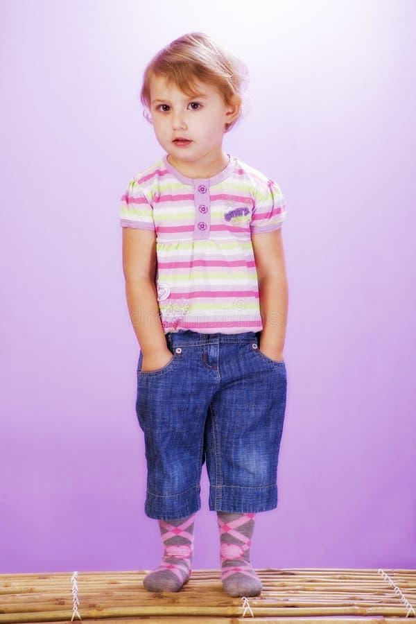 Download Girl On A Violet Background, Hands In Pocket Stock Photo - Image: 16815224