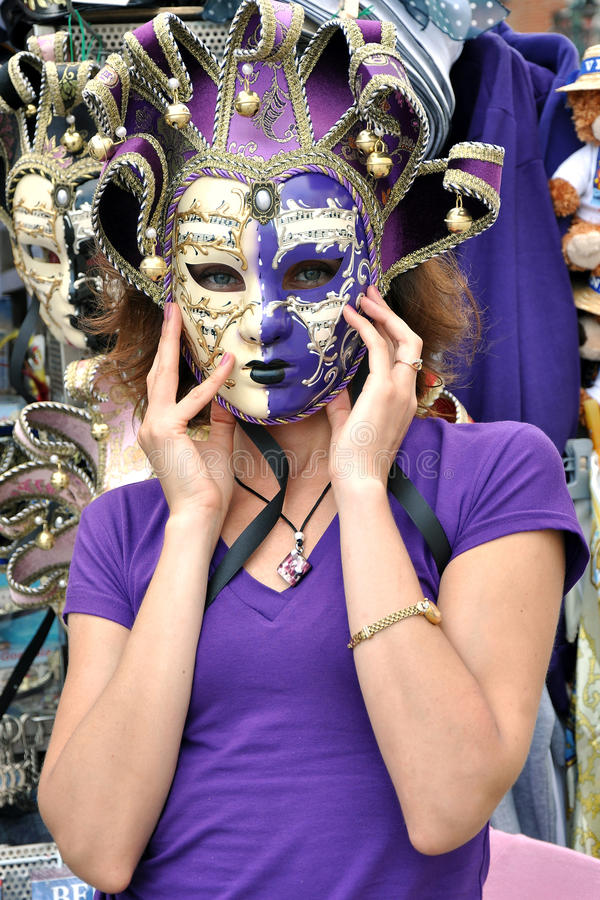 A girl in violet mask royalty free stock image