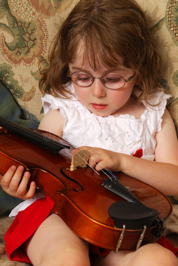 Girl With A Violin Stock Images