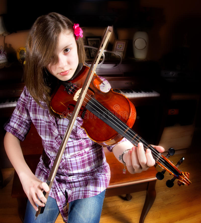 Girl and Violin royalty free stock images