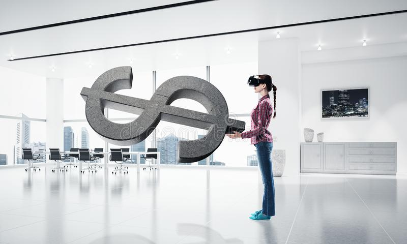 Girl in virtual reality mask experiencing virtual technology world. Mixed media royalty free stock images