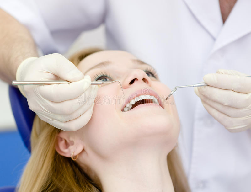 Girl visit to the dentist stock photography