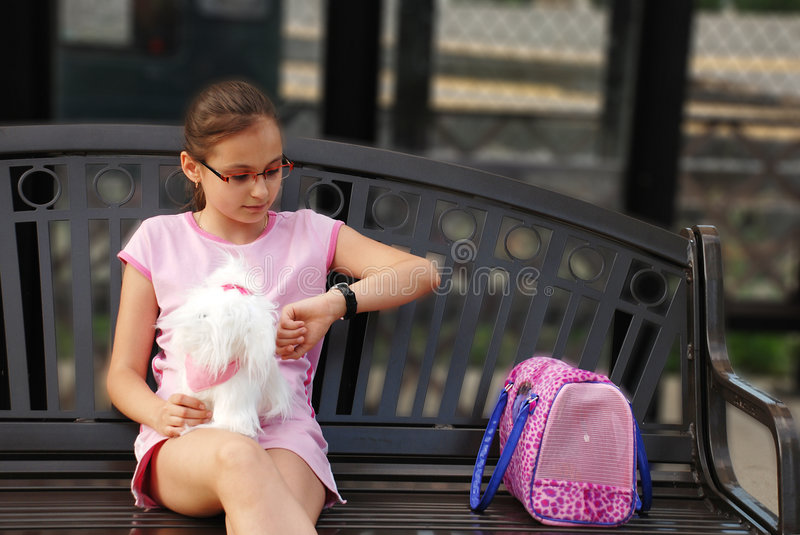 Girl waiting. Young girl is waiting on the train stop royalty free stock photos