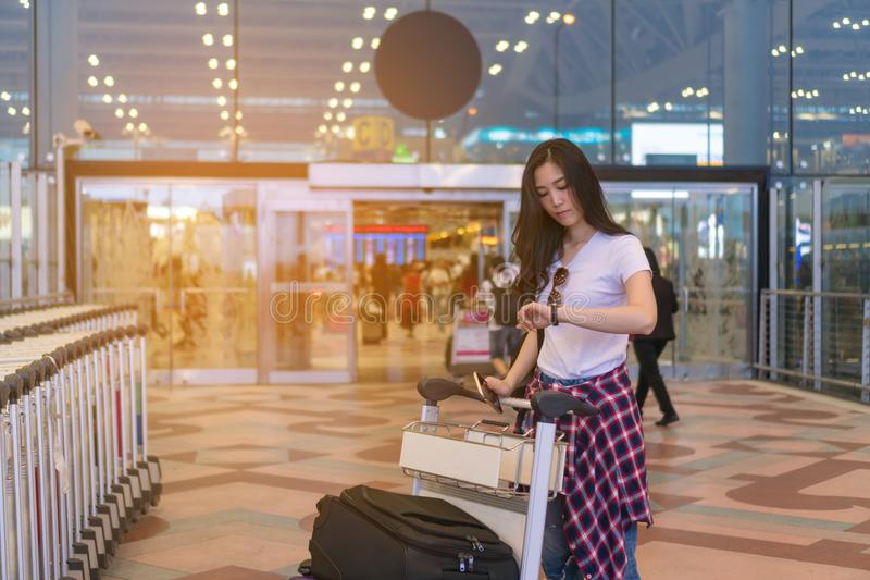 The girl is waiting for a friend. Traveling to the airport. stock photos