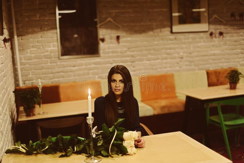 Girl waiting for man at restaurant stock images