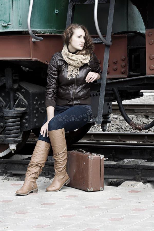 Girl waiting on the platform stock image