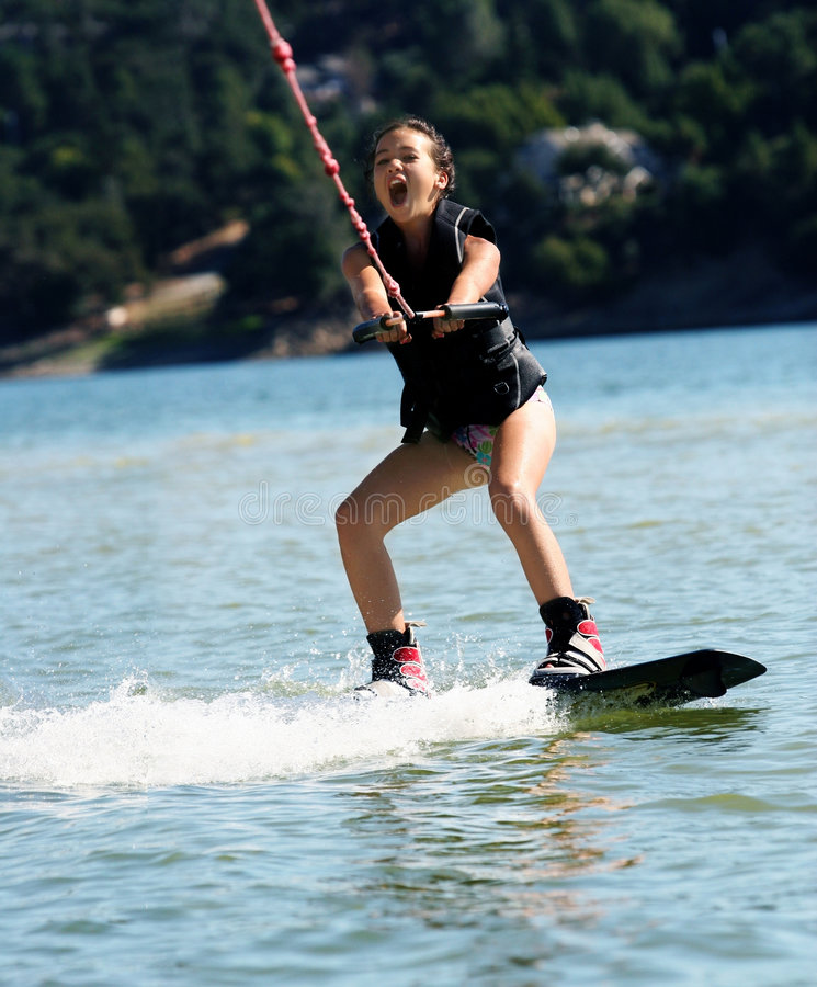 Girl wakeboarding royalty free stock images