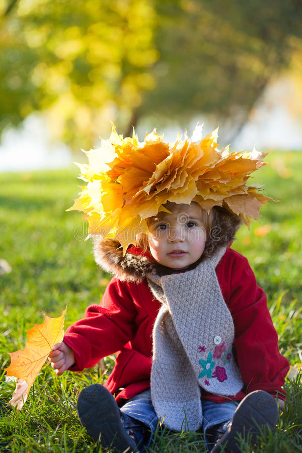 Girl on walk in autumn park stock image