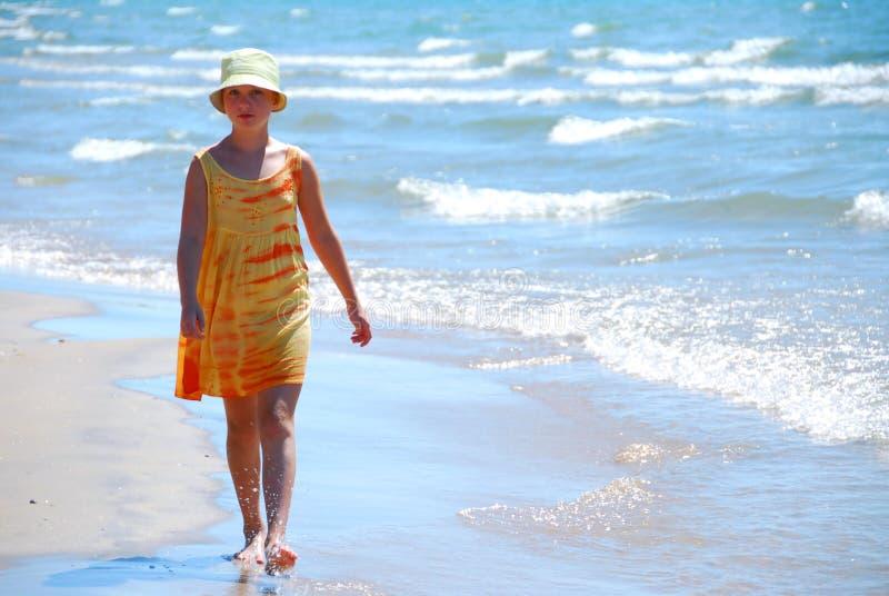 Girl walk beach royalty free stock images