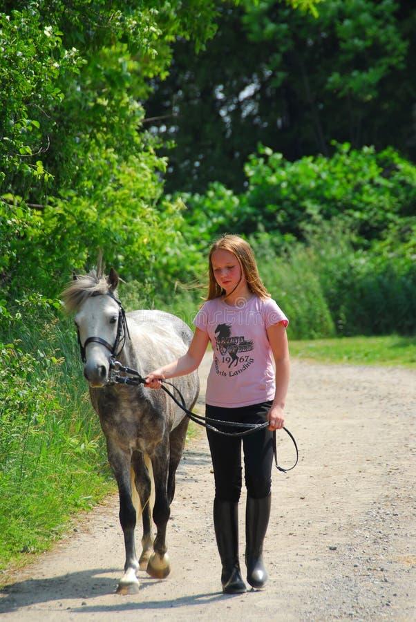 Girl walk pony stock image