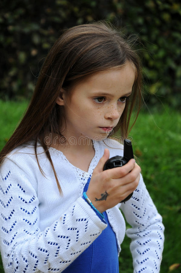 Girl with walkie talkie. Cute girl with walkie talkie royalty free stock photography