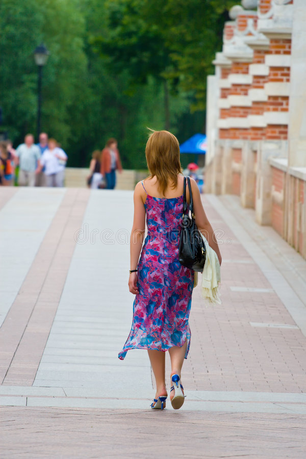 Girl walking royalty free stock photos