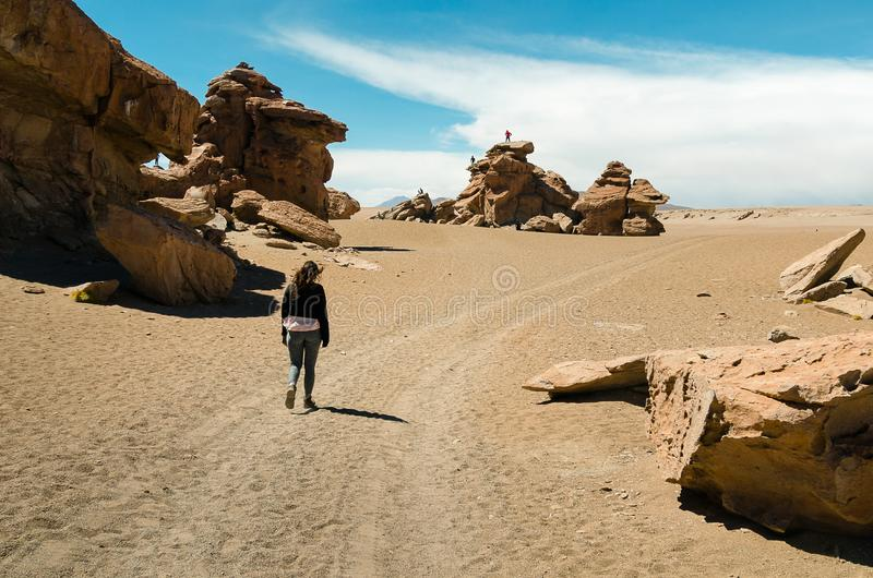 Girl walking alone in the desert stock image