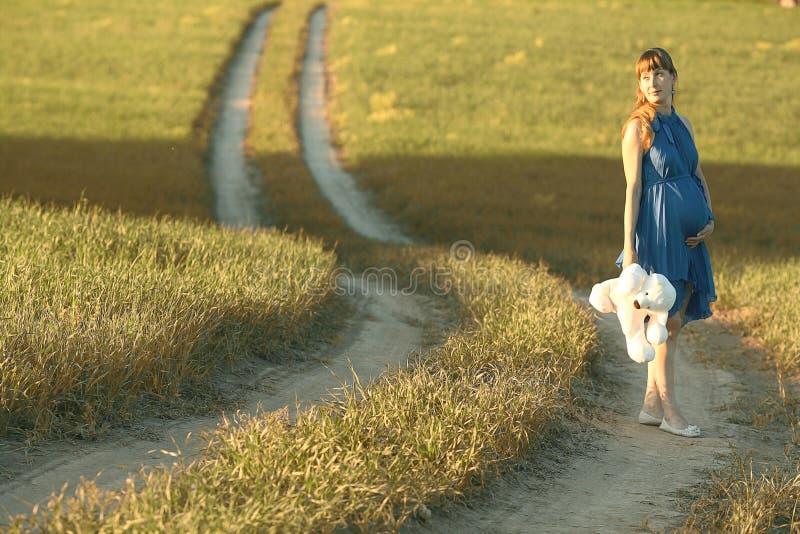 Girl walking along in field stock image