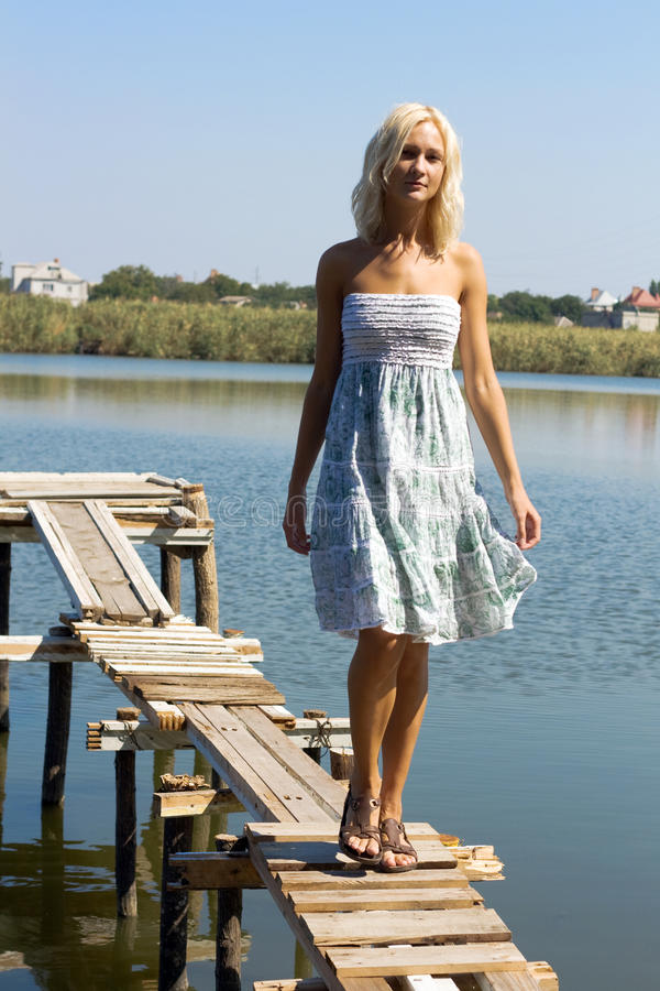 Download Girl Walking Along The Pier Stock Photo - Image: 9801754