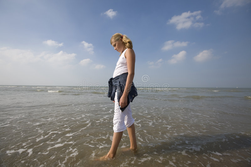 Download Girl walking at the beach stock image. Image of pants - 3769457