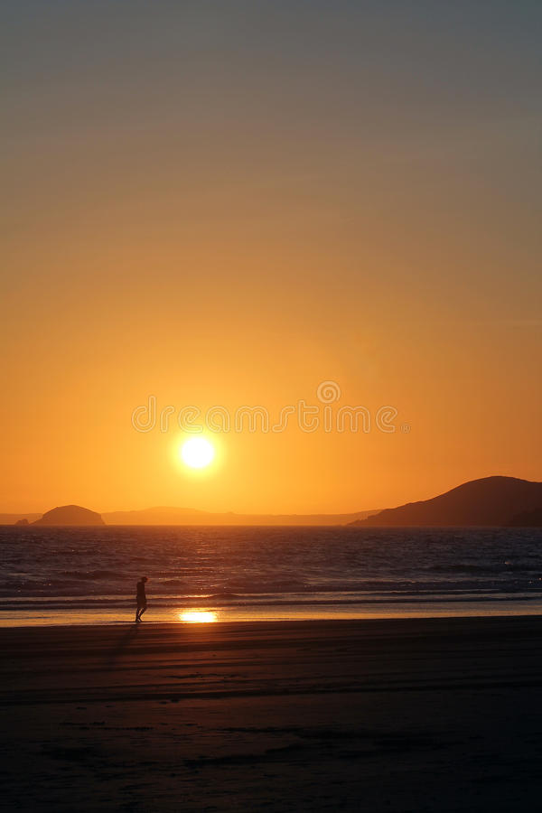 Download Girl Walking On Beach With Sunset Stock Photo - Image of sunset, walker: 26530094
