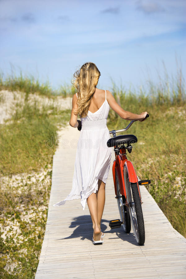 Girl Walking Bike On Boardwalk Stock Image