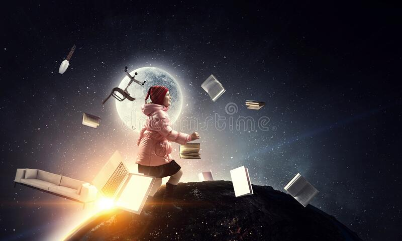 Girl walking with book around her stock photos