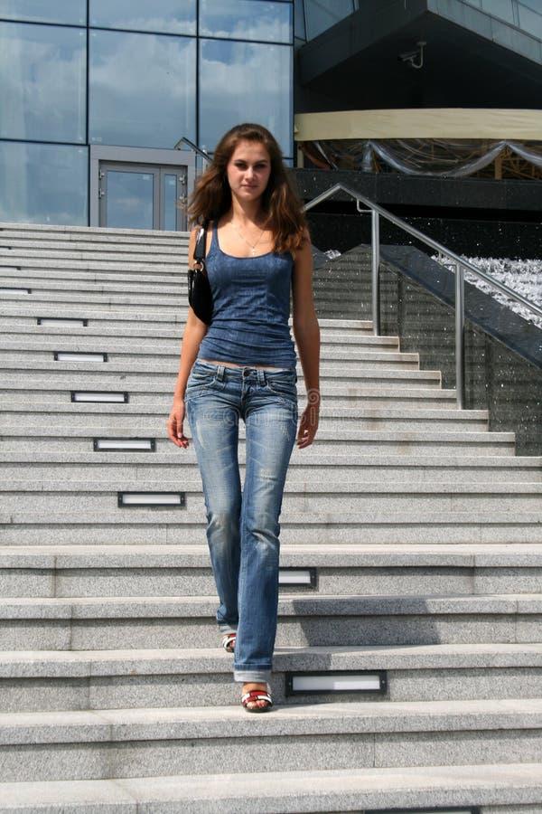 Girl walking dowstairs stock photos