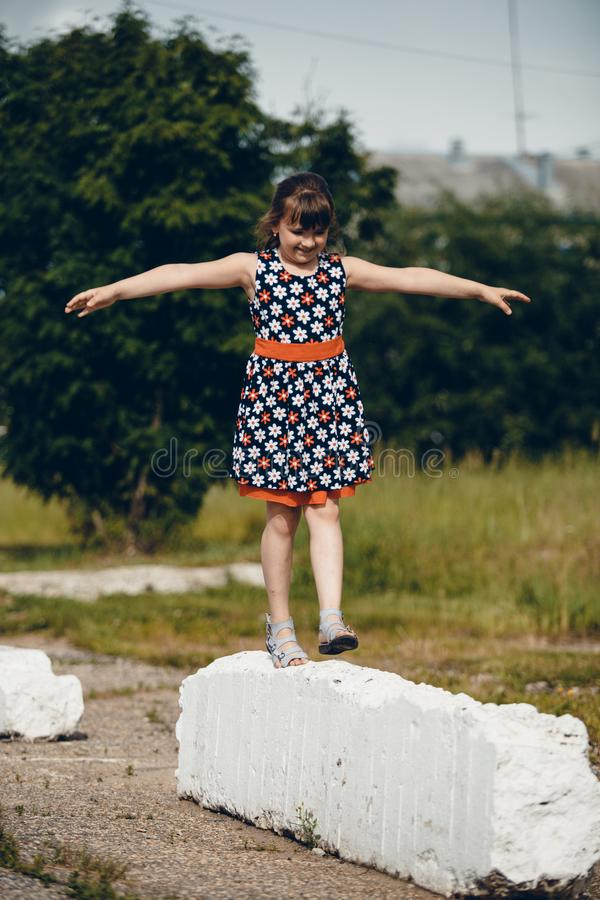 Girl walking in a dress raising her hands royalty free stock photos