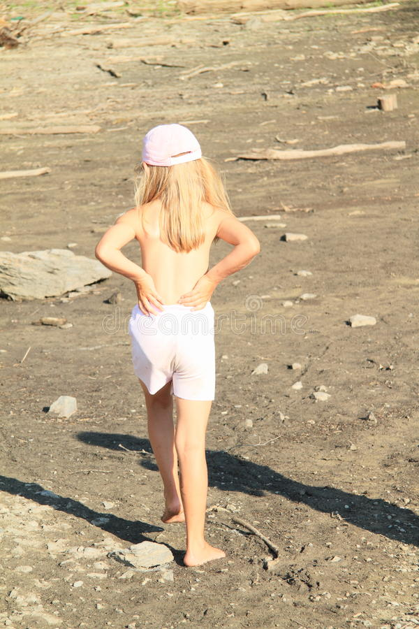 Girl walking on drying ground stock photography