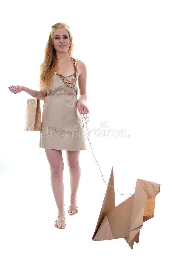 Girl walking eco dog holding paper recycle bag royalty free stock photo