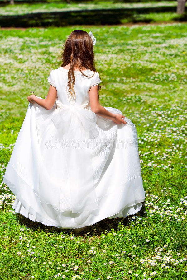 Girl walking in flower field. royalty free stock photography