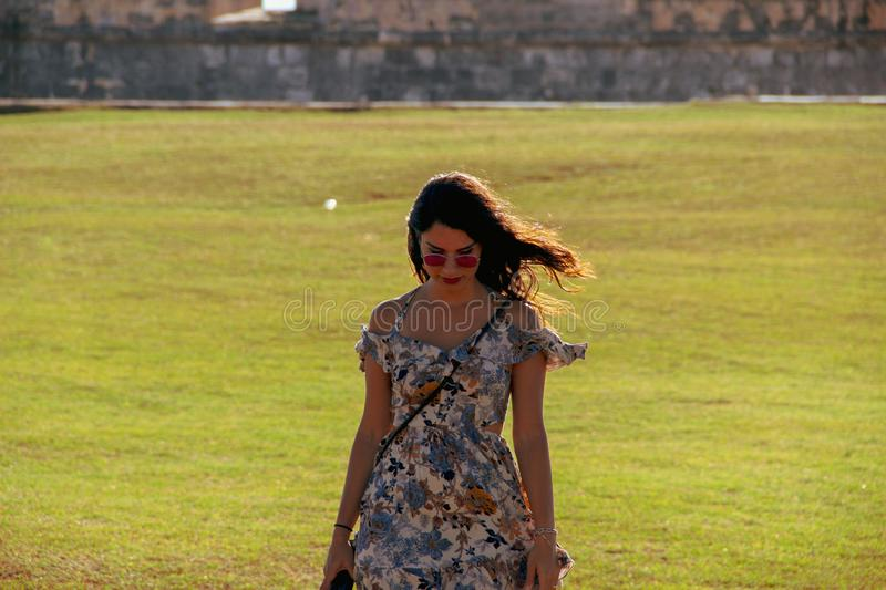 Girl walking on the grass of lighthouse in Havana Fort in Havana, Cuba royalty free stock photo