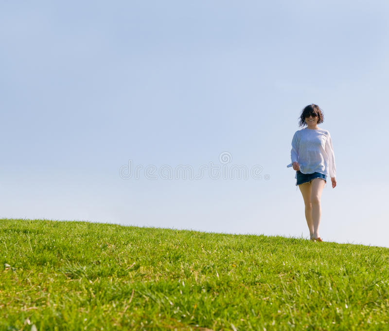 Download Girl Walking On The Green Hill Stock Photos - Image: 9659443