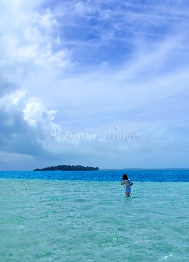 Download Girl Walking in Lagoon stock image. Image of clouds, palm - 116781