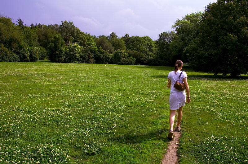 Girl walking through meadow