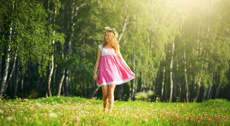 Girl walking on meadow royalty free stock images