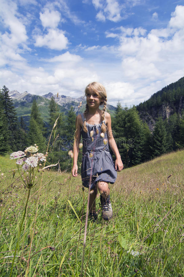 Girl walking in mountains royalty free stock photography
