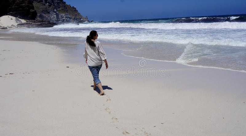 A girl is walking on the ocean royalty free stock photography