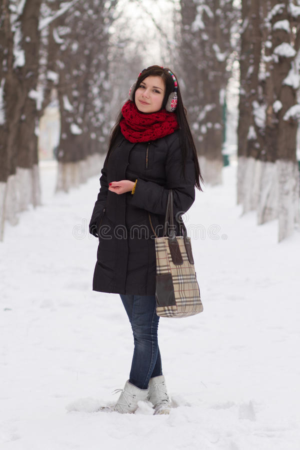 Girl walking outdoors in winter stock photography