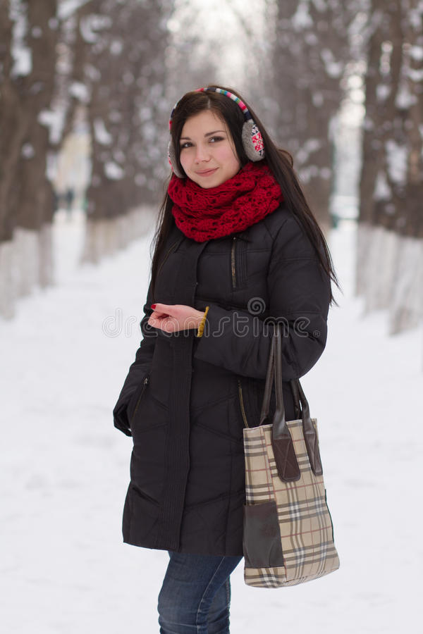 Girl walking outdoors in winter royalty free stock photos