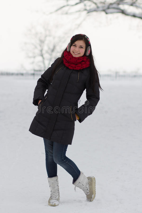 Girl walking outdoors in winter stock image