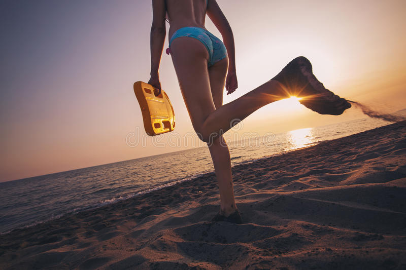 Girl walking on the sea beach royalty free stock photography