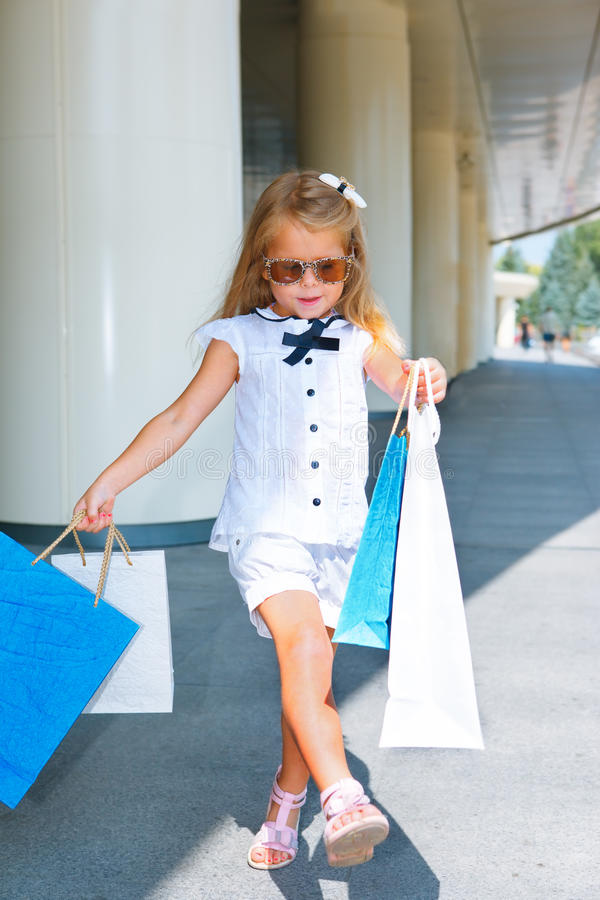 Girl walking with shopping bags royalty free stock images
