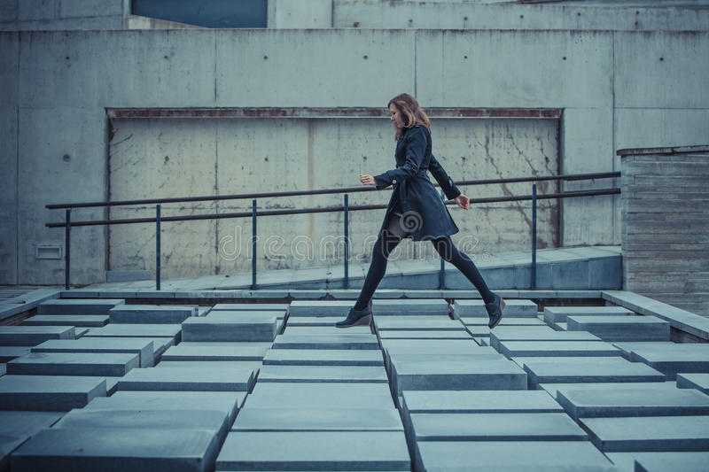 Download Girl Walking On The Slabs Royalty Free Stock Photo - Image: 27385545