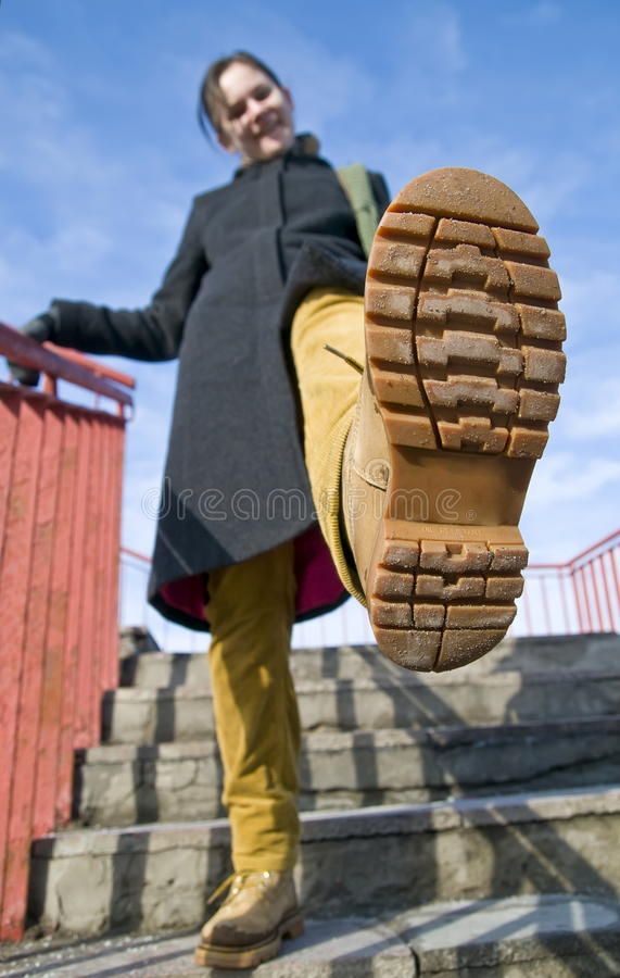 A girl walking on stairs. royalty free stock photography