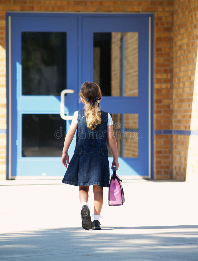 Girl walking to school royalty free stock photos