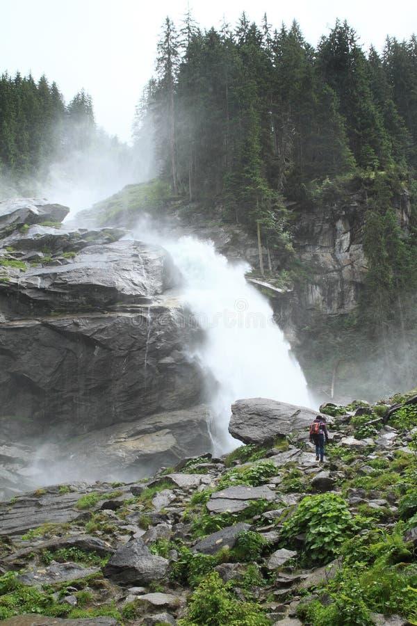 Girl walking to waterfall royalty free stock image
