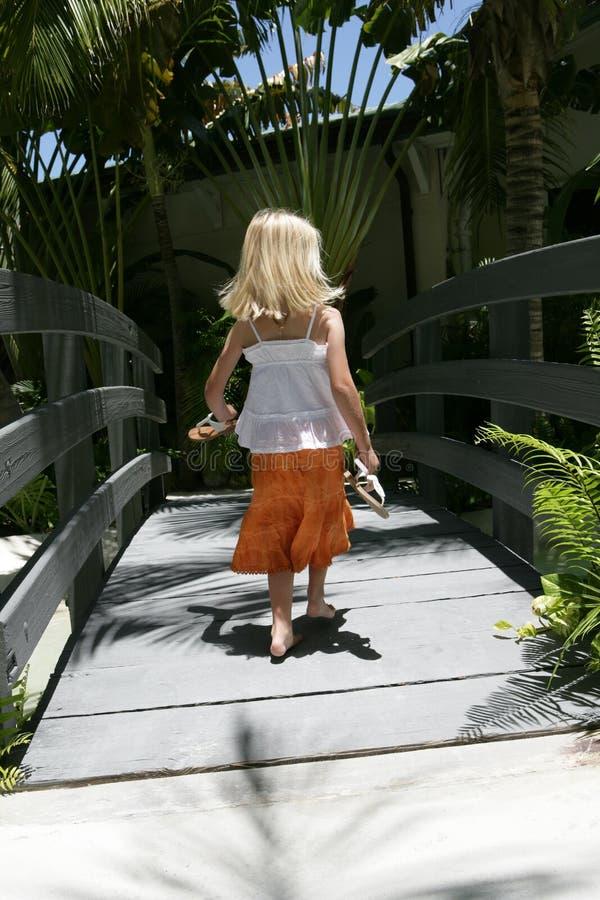Girl Walking In Tropical Scene Royalty Free Stock Photos