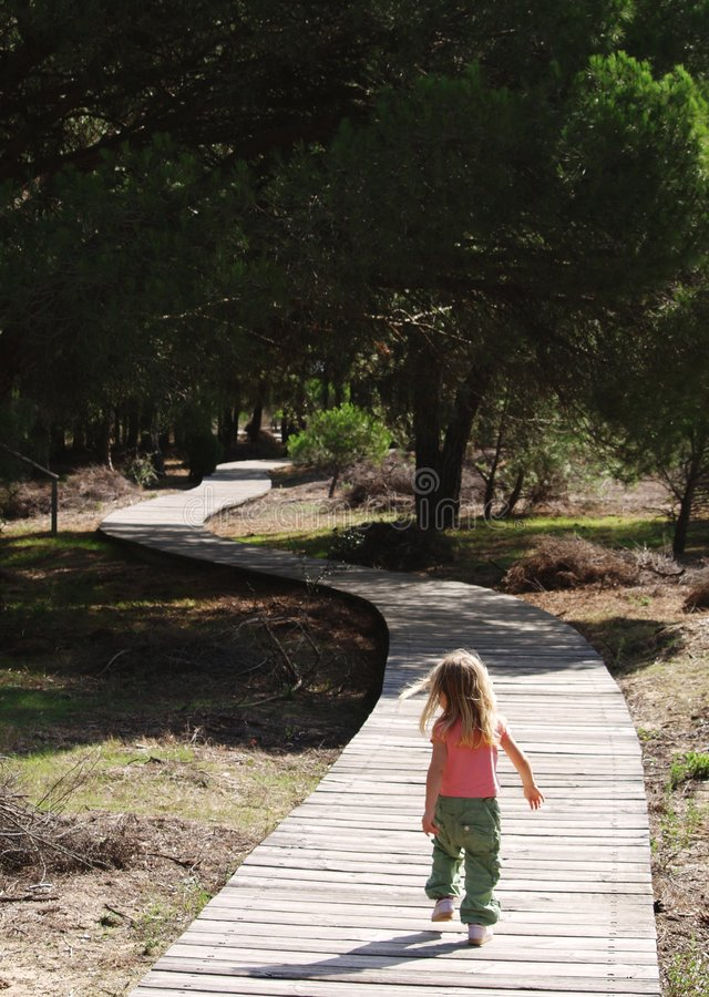 girl walking up path