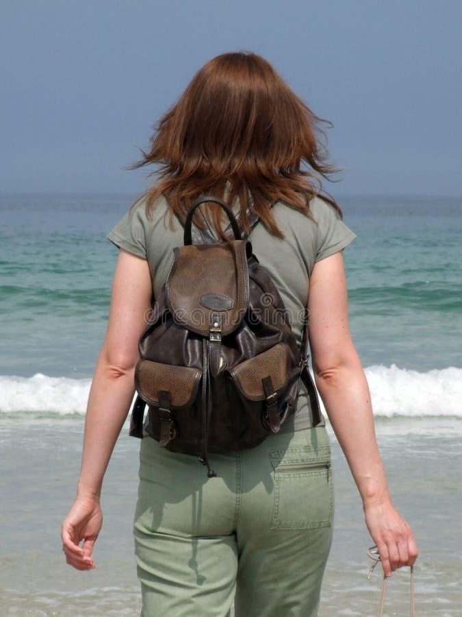 A girl walks into the sea royalty free stock photo
