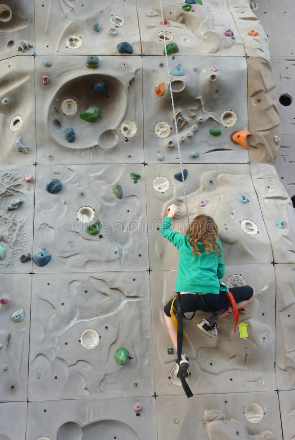 Girl on the wall royalty free stock photos