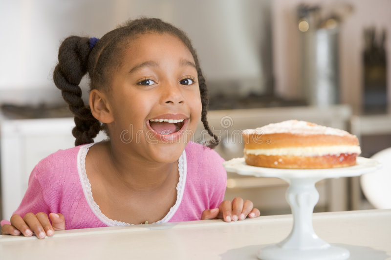 Girl wanting cake at home stock photography